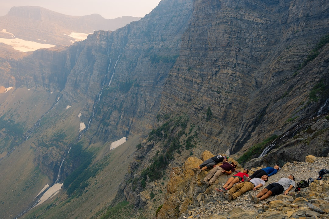 During our 12 mile hike from Highline trail to Swiftcurrent pass, we stopped at an overlook that featured a random glacier waterfall in the background. We thought this was a good time to do a quick yoga post on the side of the cliff!