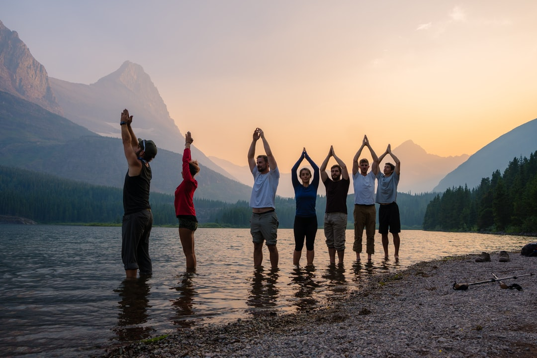 During our 12 mile hike from Highline trail to Swiftcurrent pass, we stopped at RedRock Lake to look at some Moose, across the lake, as well as do some white people things, that included yoga pose. This is us, doing a (poor) mountain pose, while surrounded by mountains.