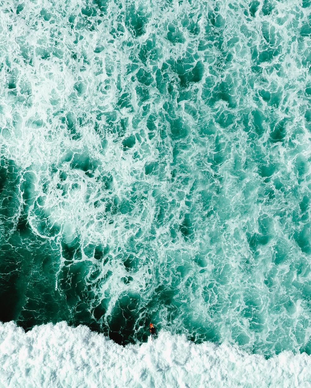 sea water crashes on rocks