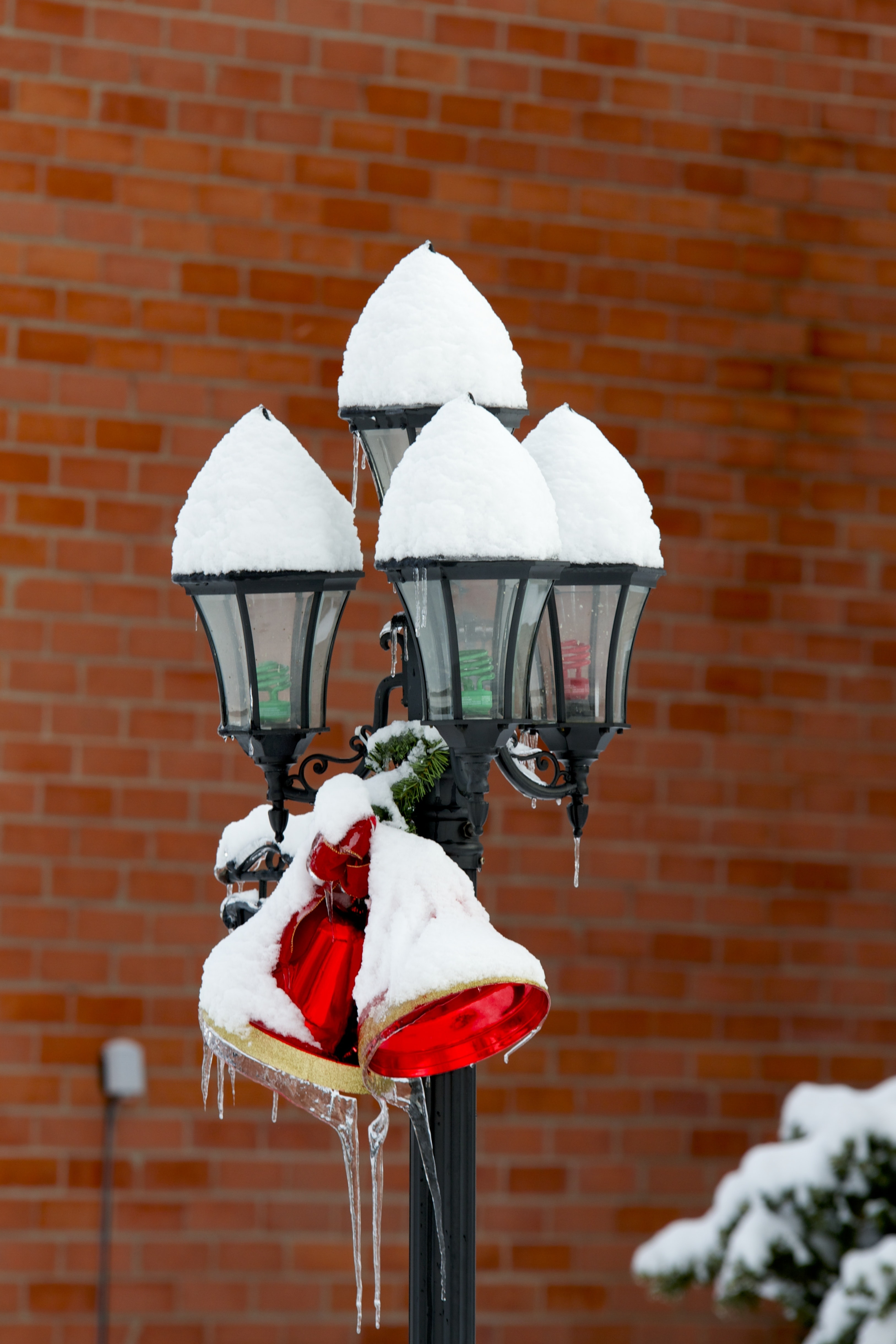 white lamppost covered in snow