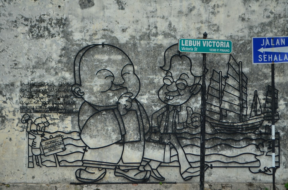 two man standing and walking mural