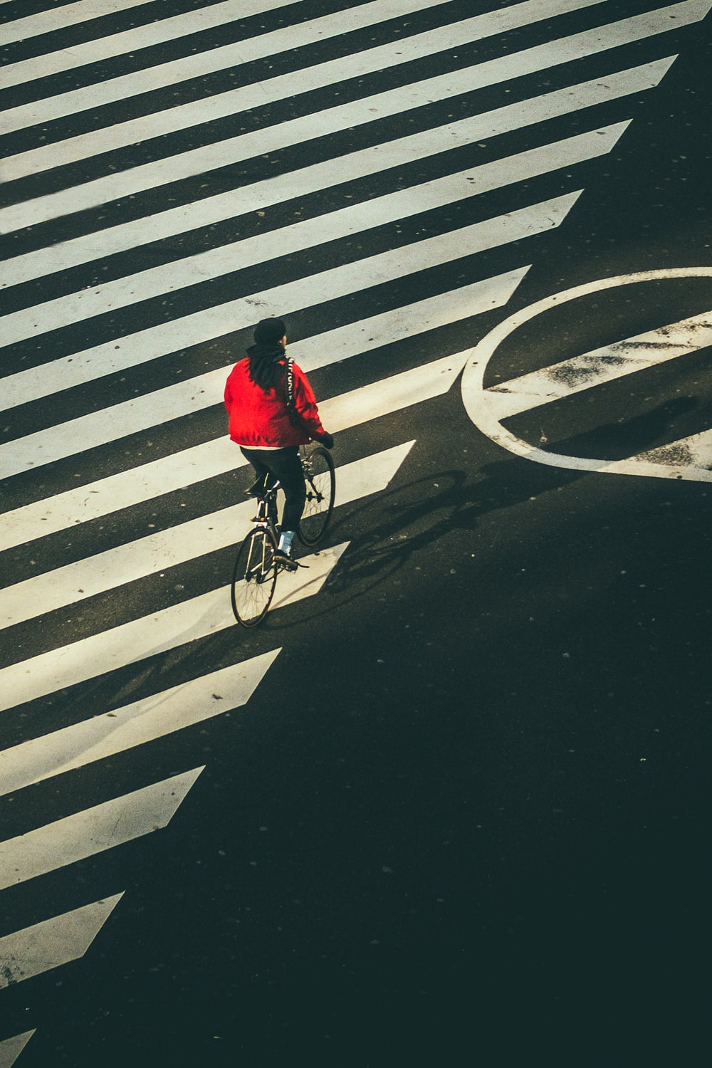 person riding on bicycle on street during daytime