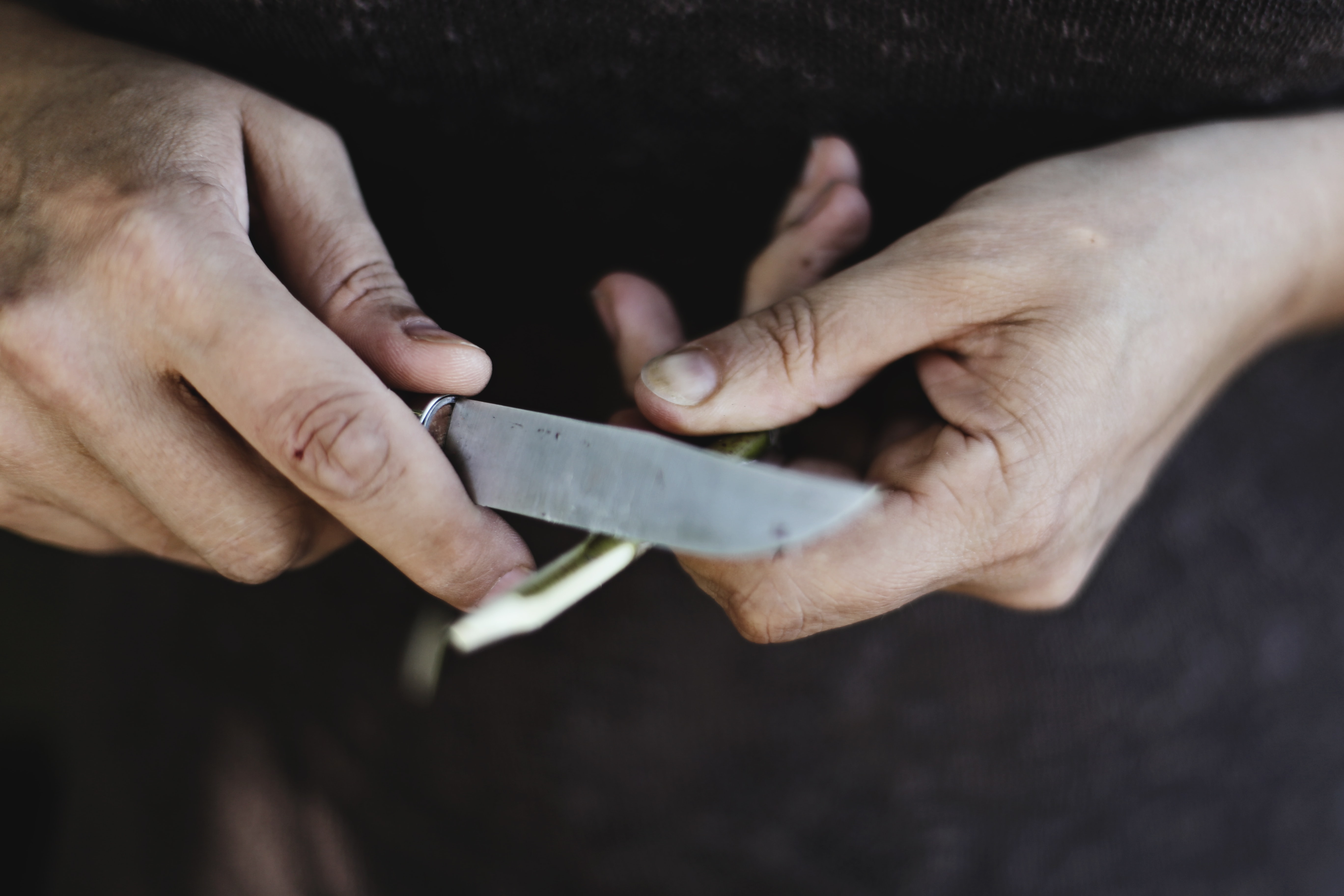 person holding knife