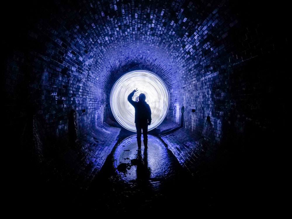 person standing on tunnel