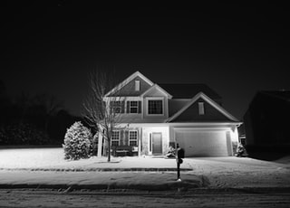lighted white and grey house