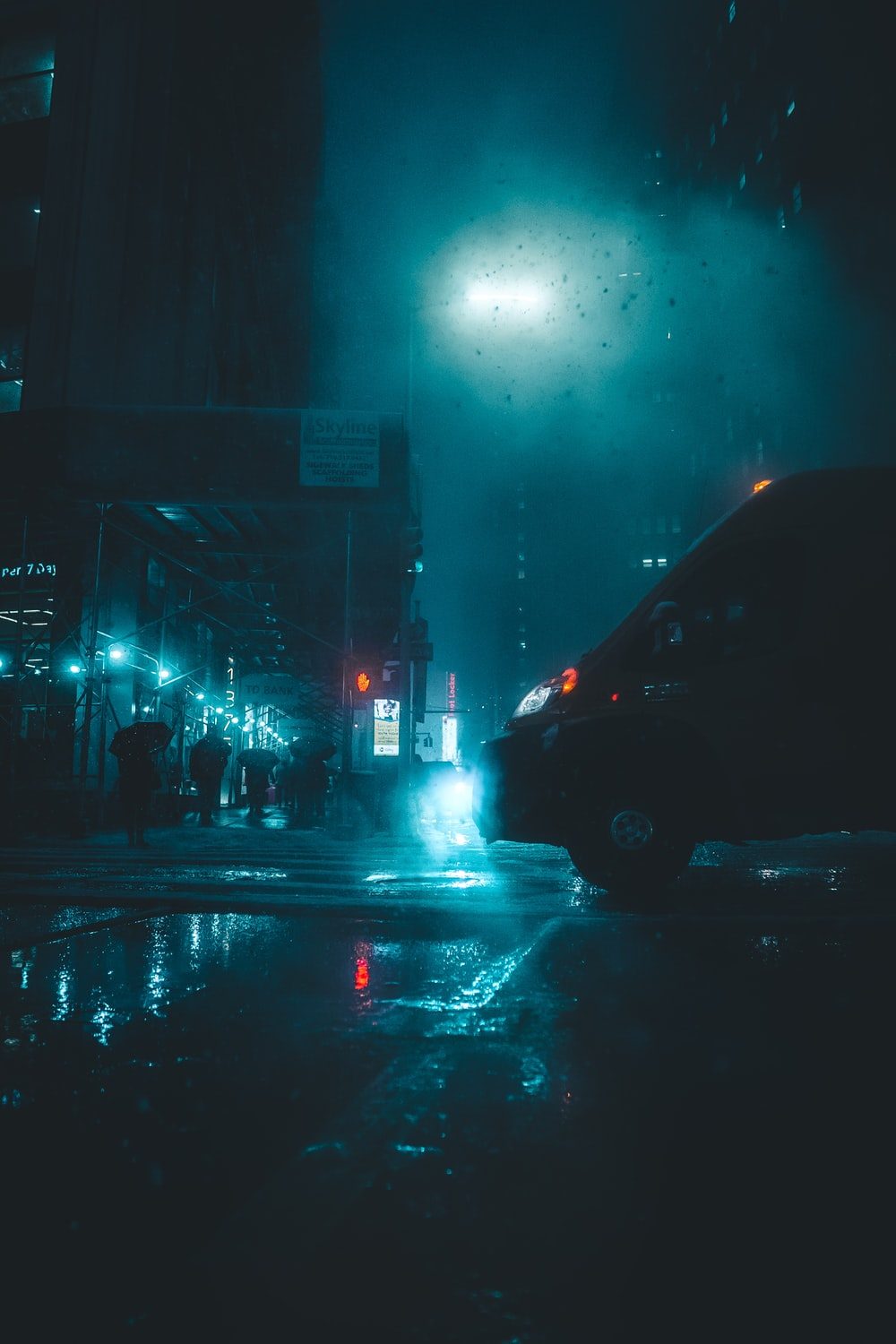 vehicle passing by wet road during nighttime