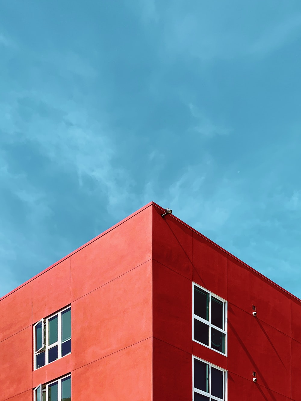 photo of rooftop of red building