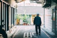 man standing between houses