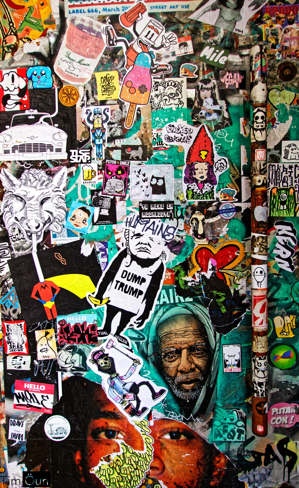 assorted stickers on wall
