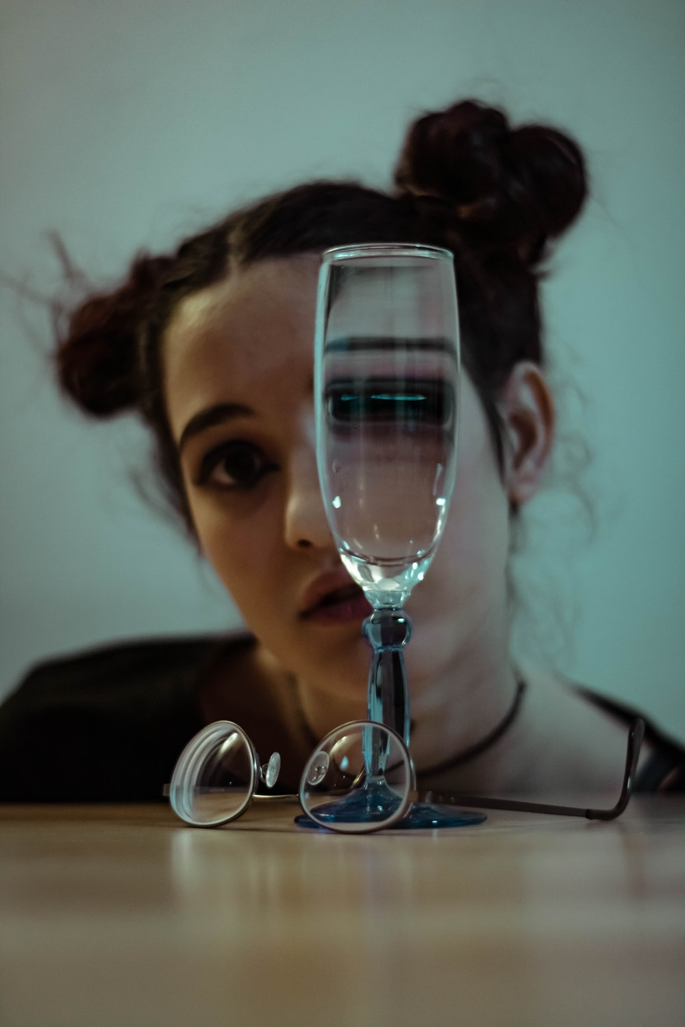 clear glass wine glass on top of table overlooking woman