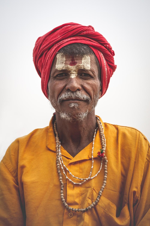 man wearing red headdress