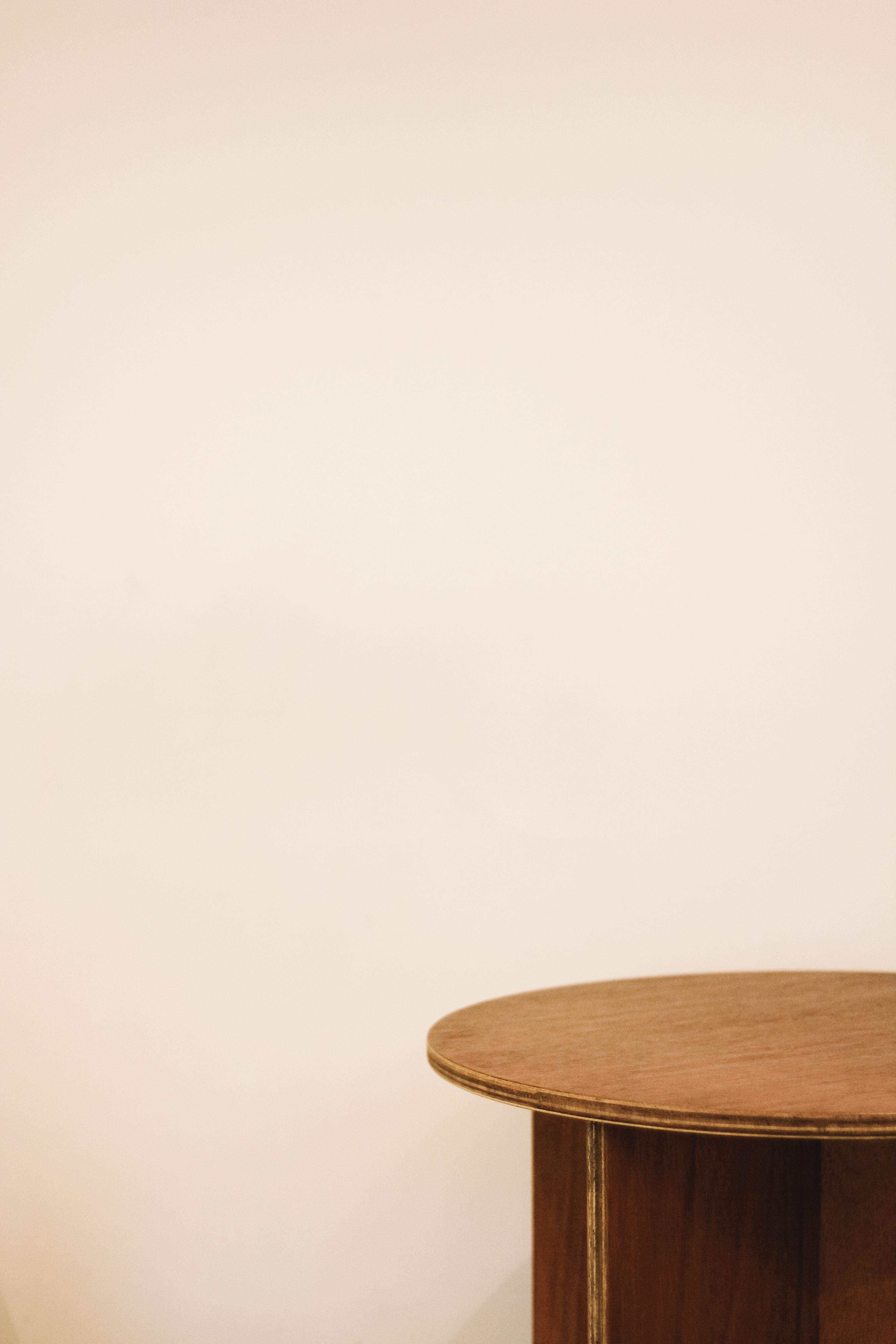 round brown wooden pedestal table