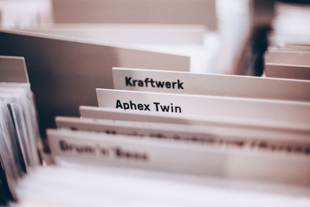 """labeled folders """"Kraftwerk"""" and """"Aphex Twin"""" after using the best label maker"""