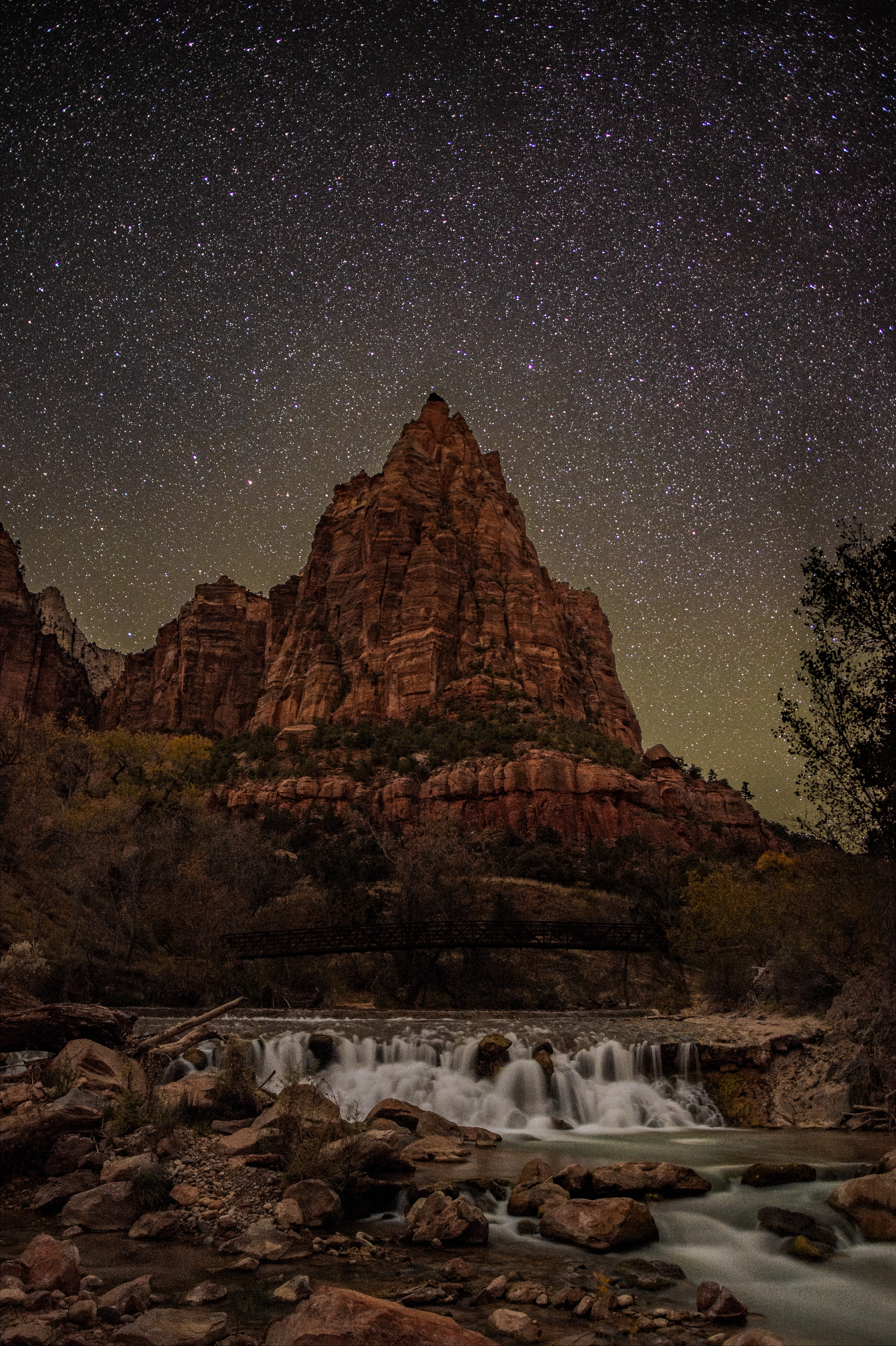 timelapse photography of river overlooking rock mountain at night time