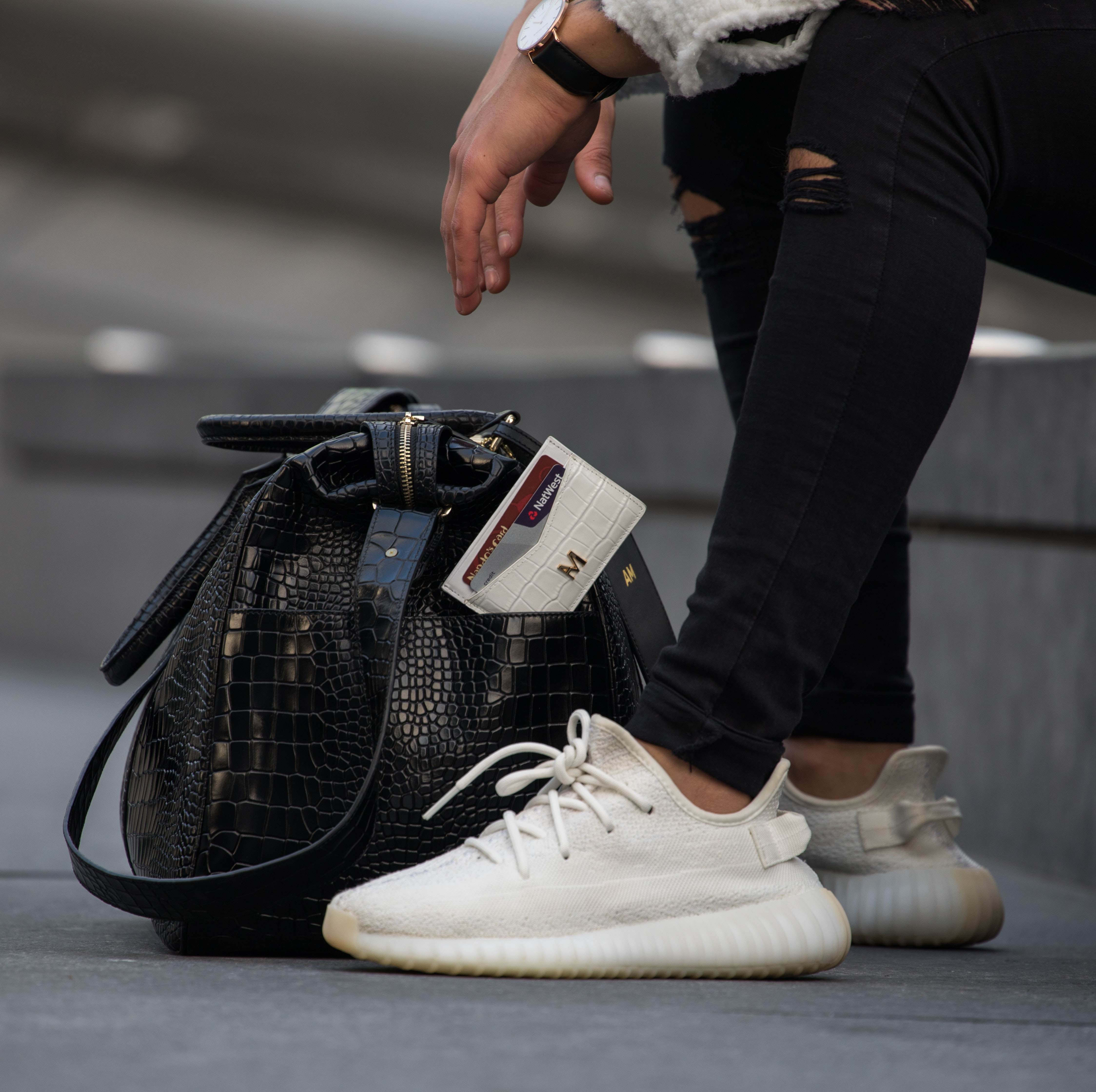 pair of black-and-white Adidas sneakers
