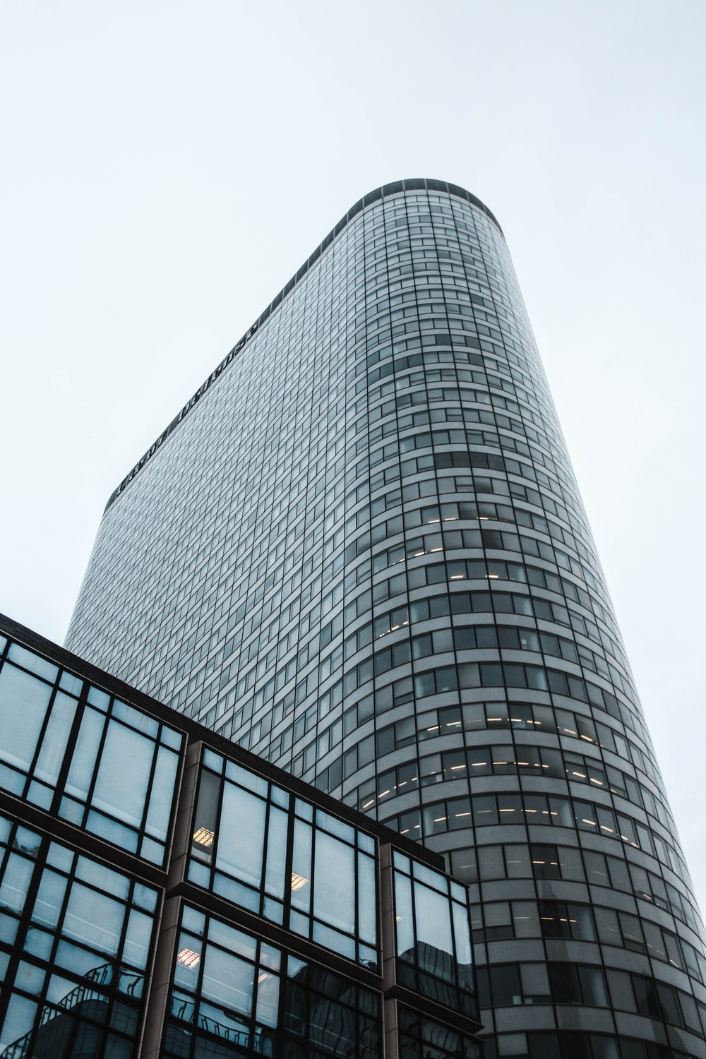 high-rise building under white sky