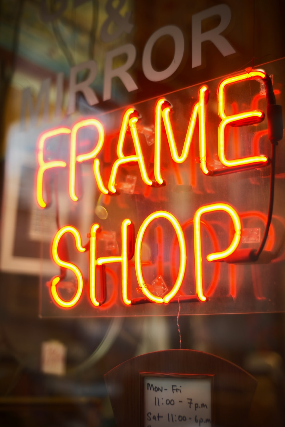 Frame Shop neon signage turned on window