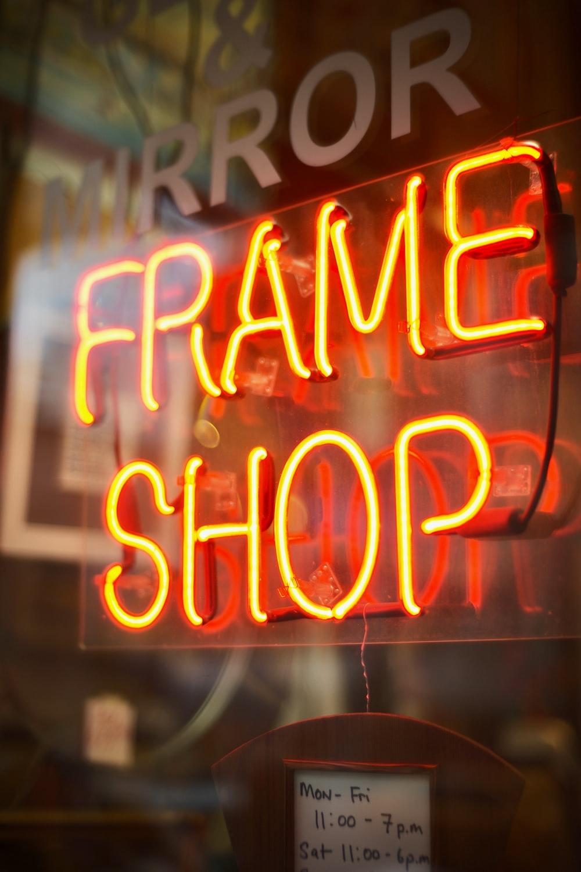Frame Shop neon signage turned on window