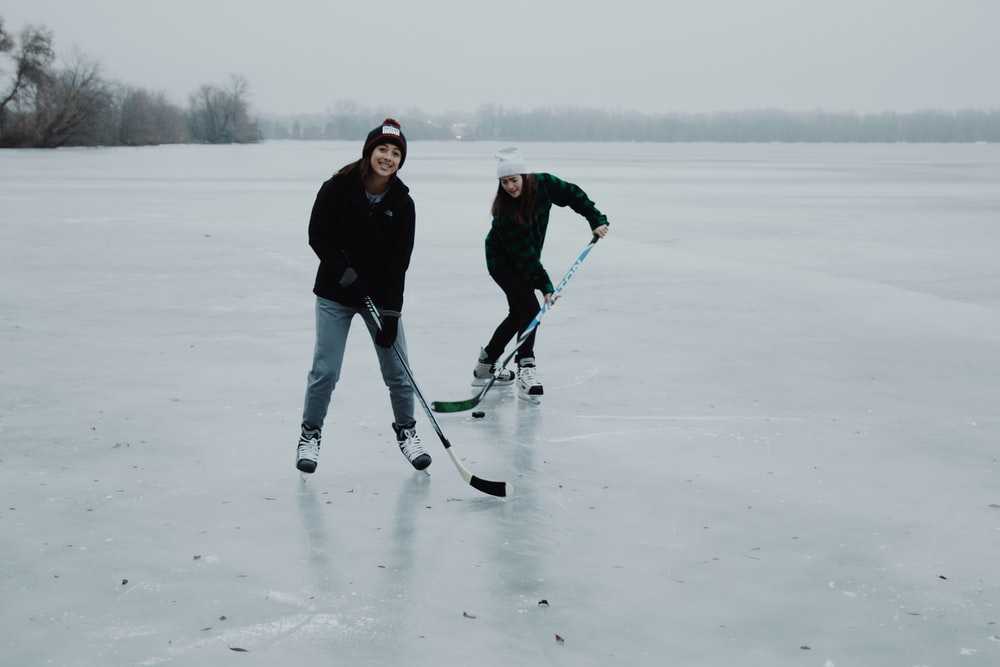 two women playing ice hockey