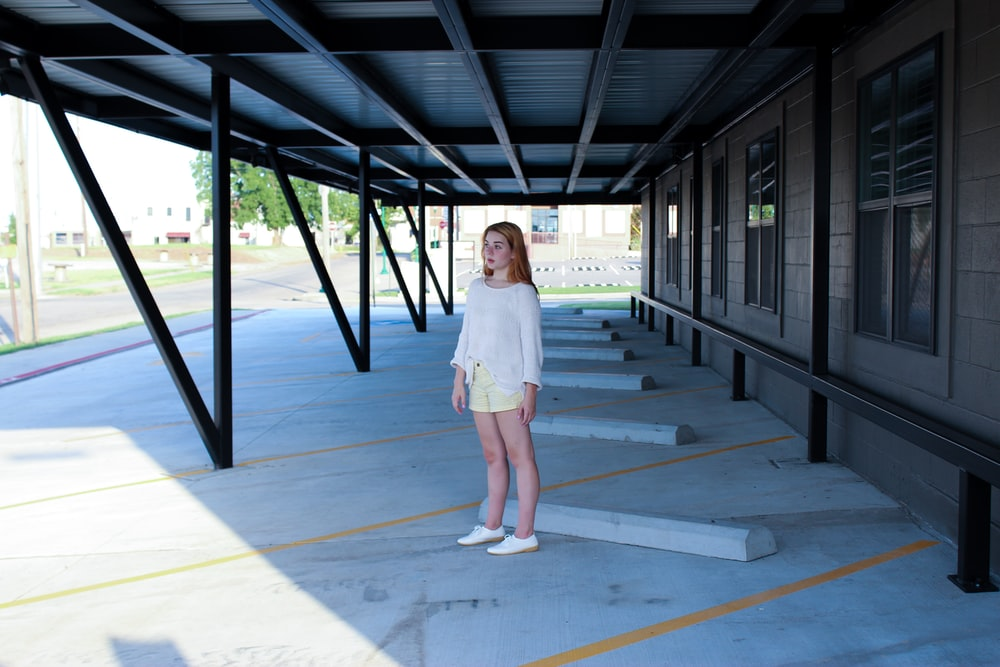 woman standing on parking lot