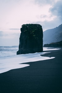 stone formation near shore
