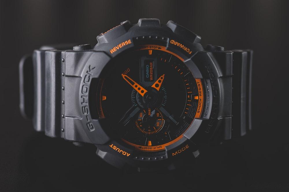 round black and orange Casio G-Shock analog watch