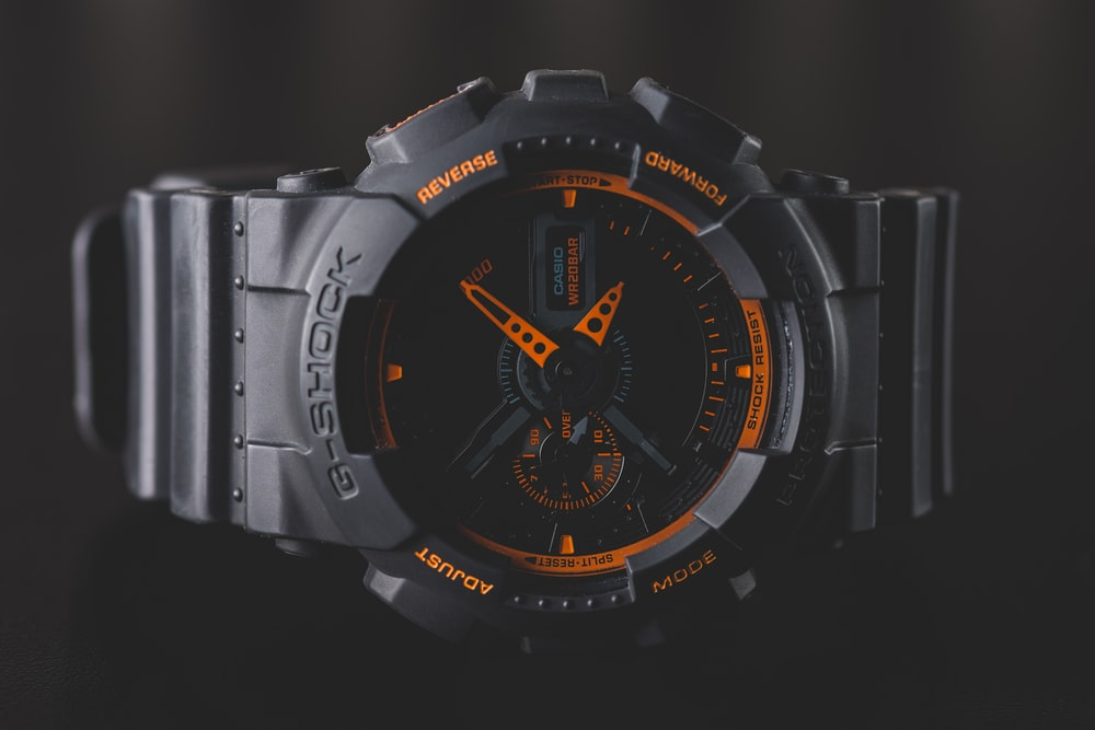 round black and orange Casio G-Shock analog watch