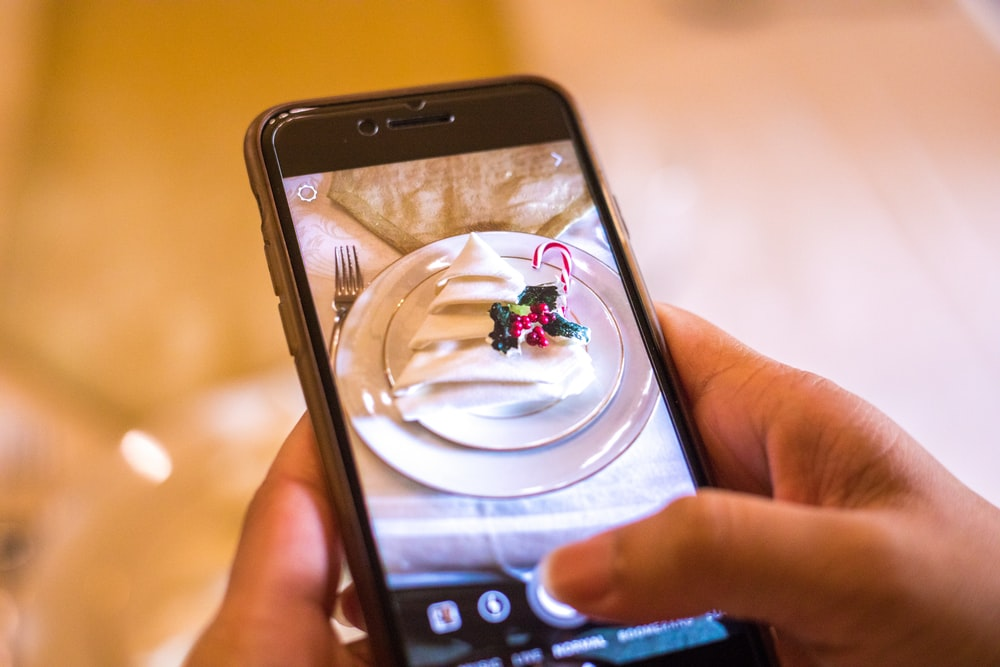 smartphone showing white ceramic saucer