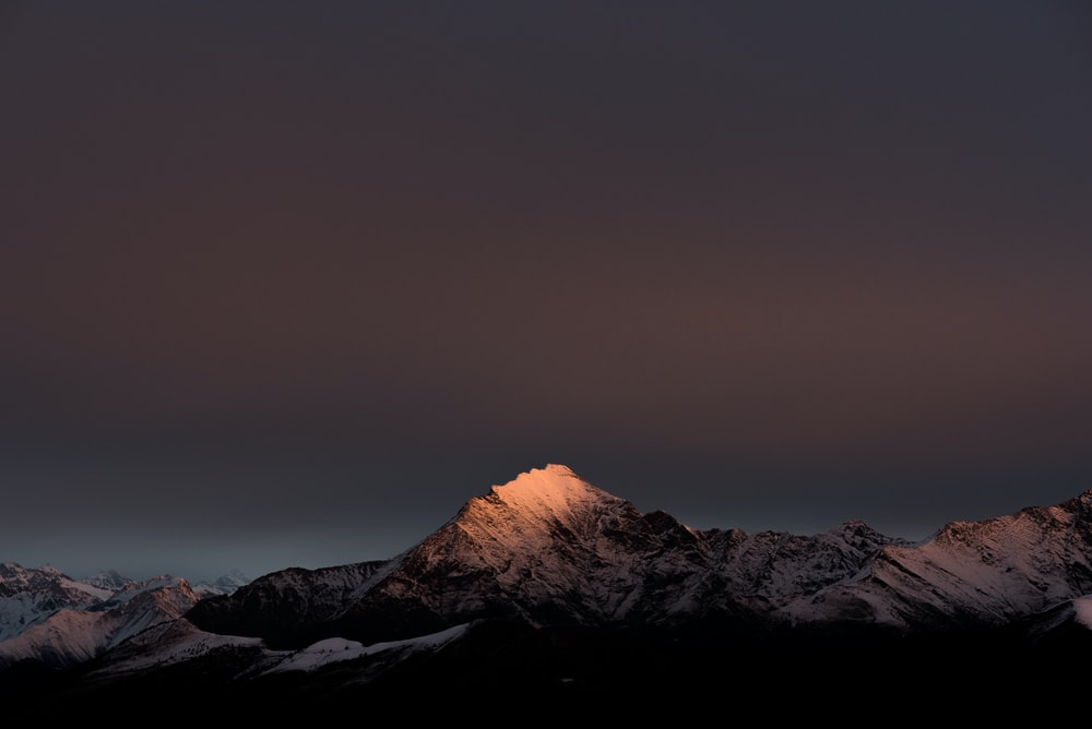 snow covered mountain during nightime