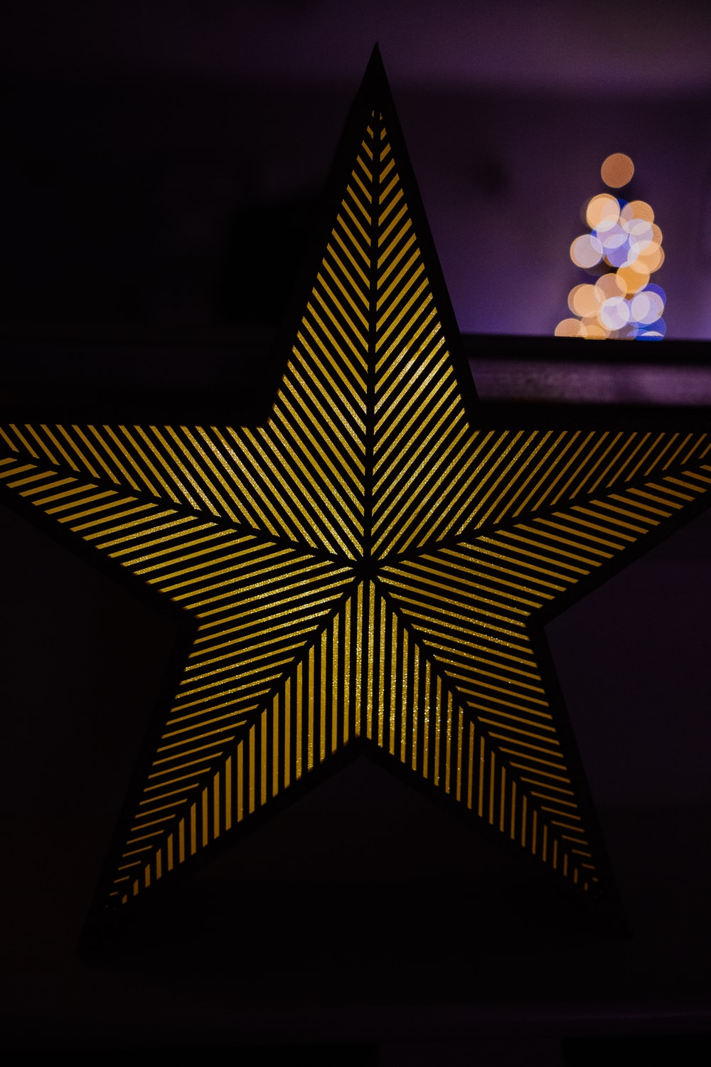 yellow and black star ornament