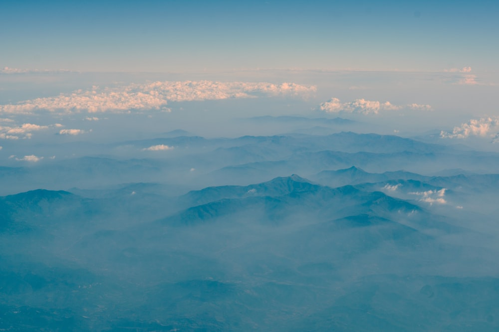 fog covering mountains during daytime