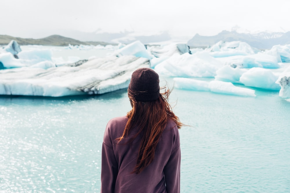person standing in front of body of water