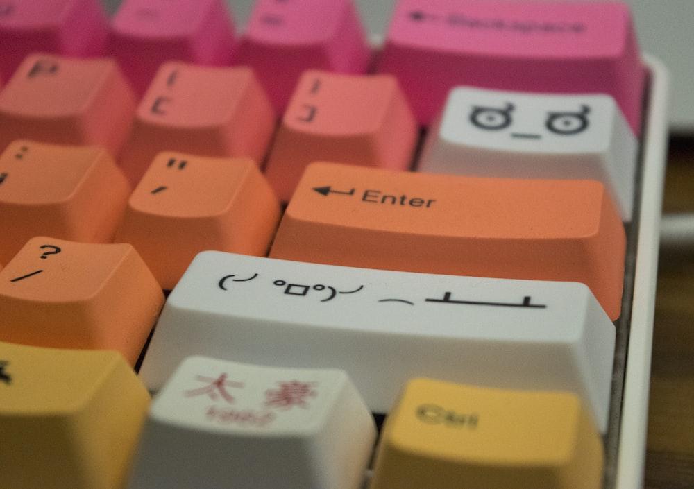 orange and pink computer keyboard