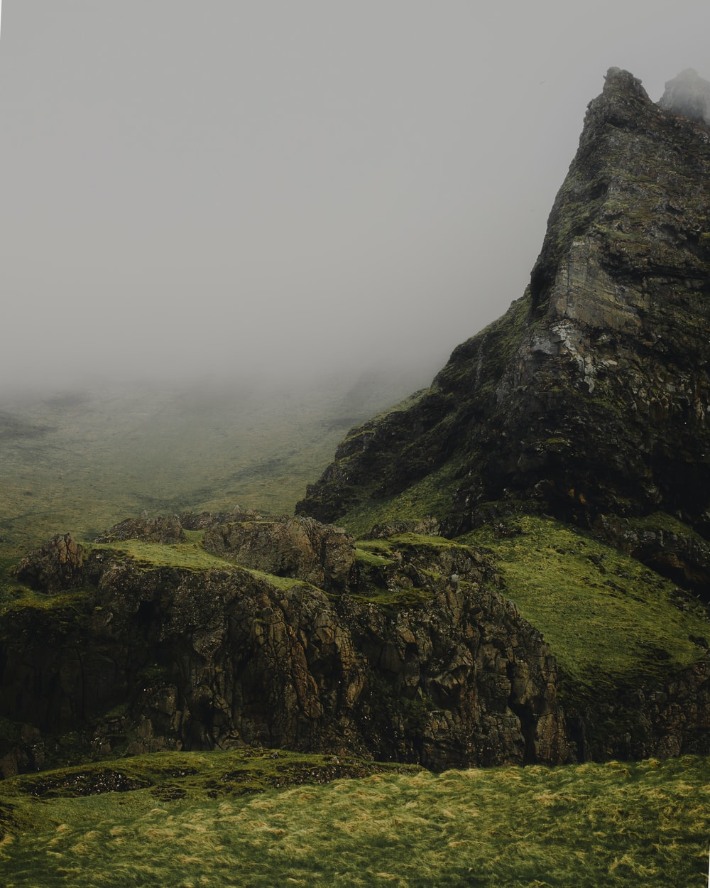 gray and green mountain and thick mist during daytime