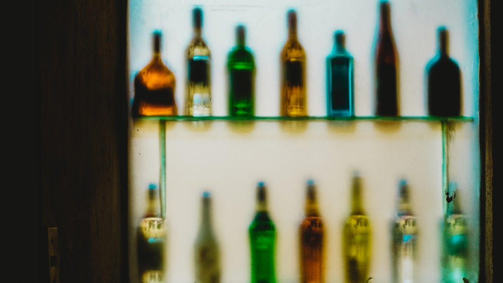 glass bottles on shelves