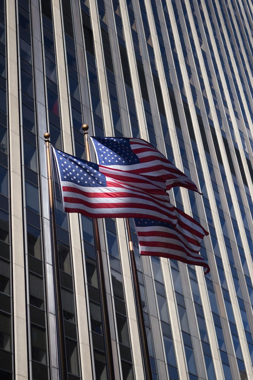 three waving US flags