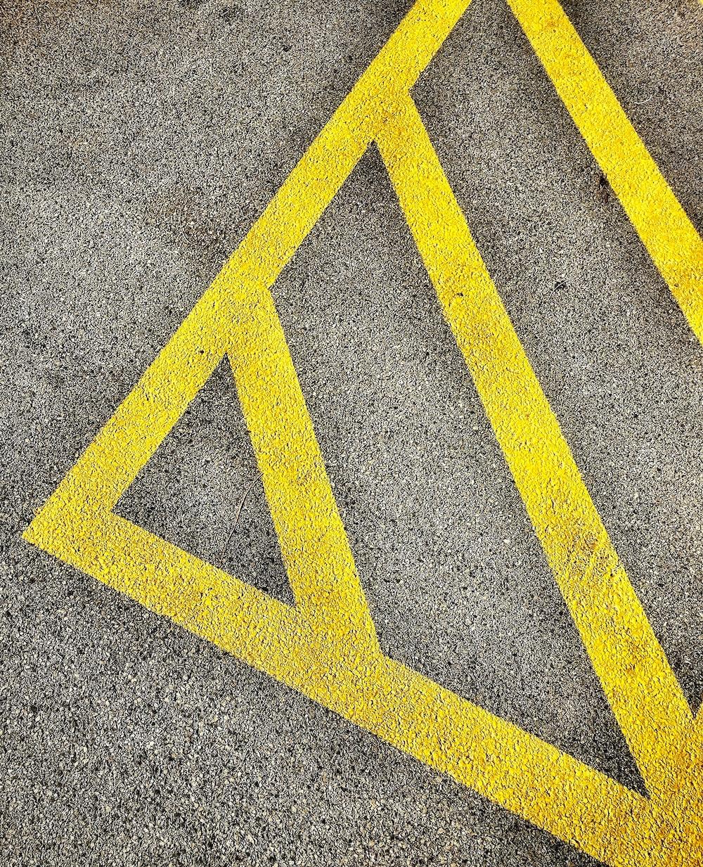 gray and yellow concrete pavement close-up photo