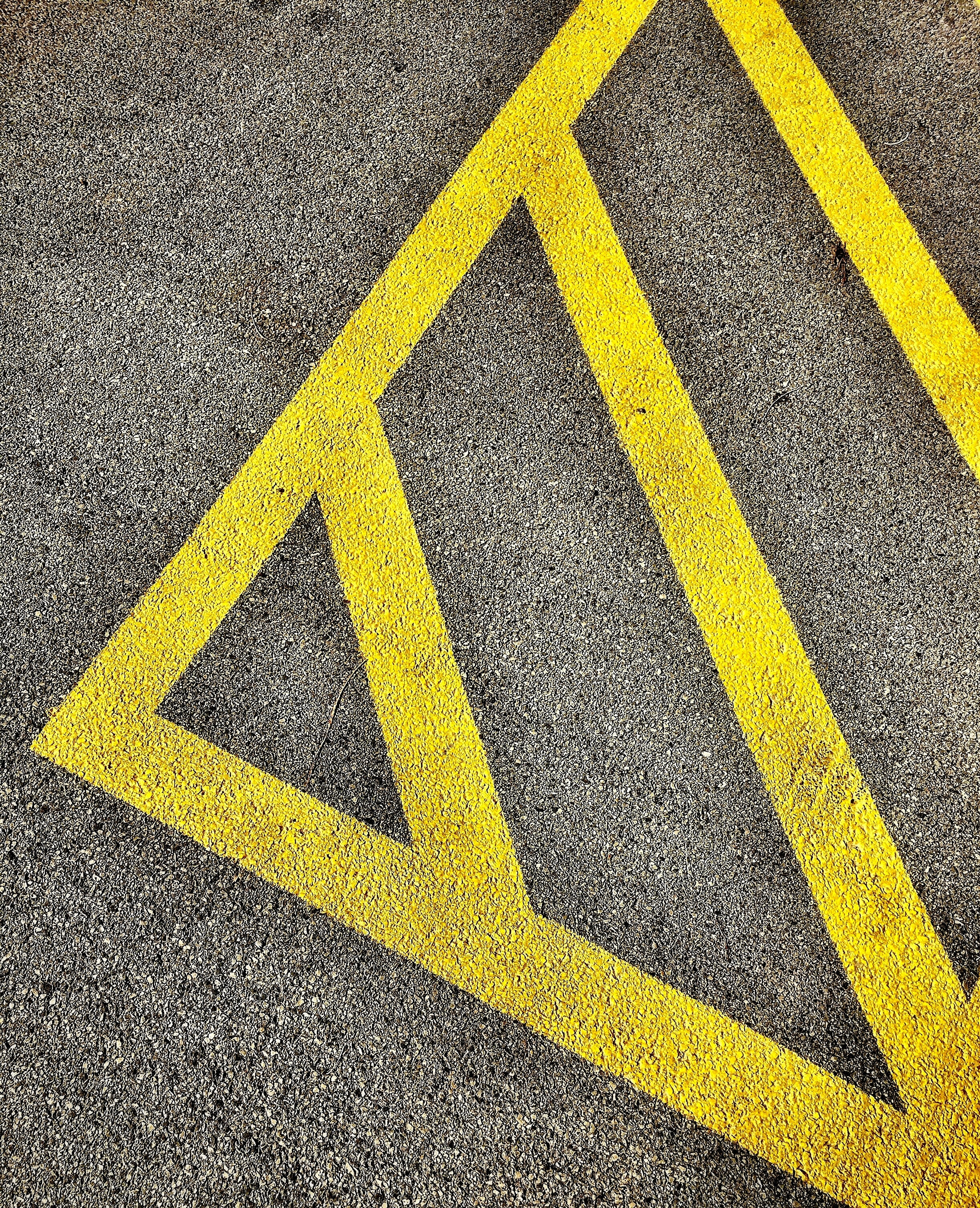 gray and yellow concrete pavement close-up photo