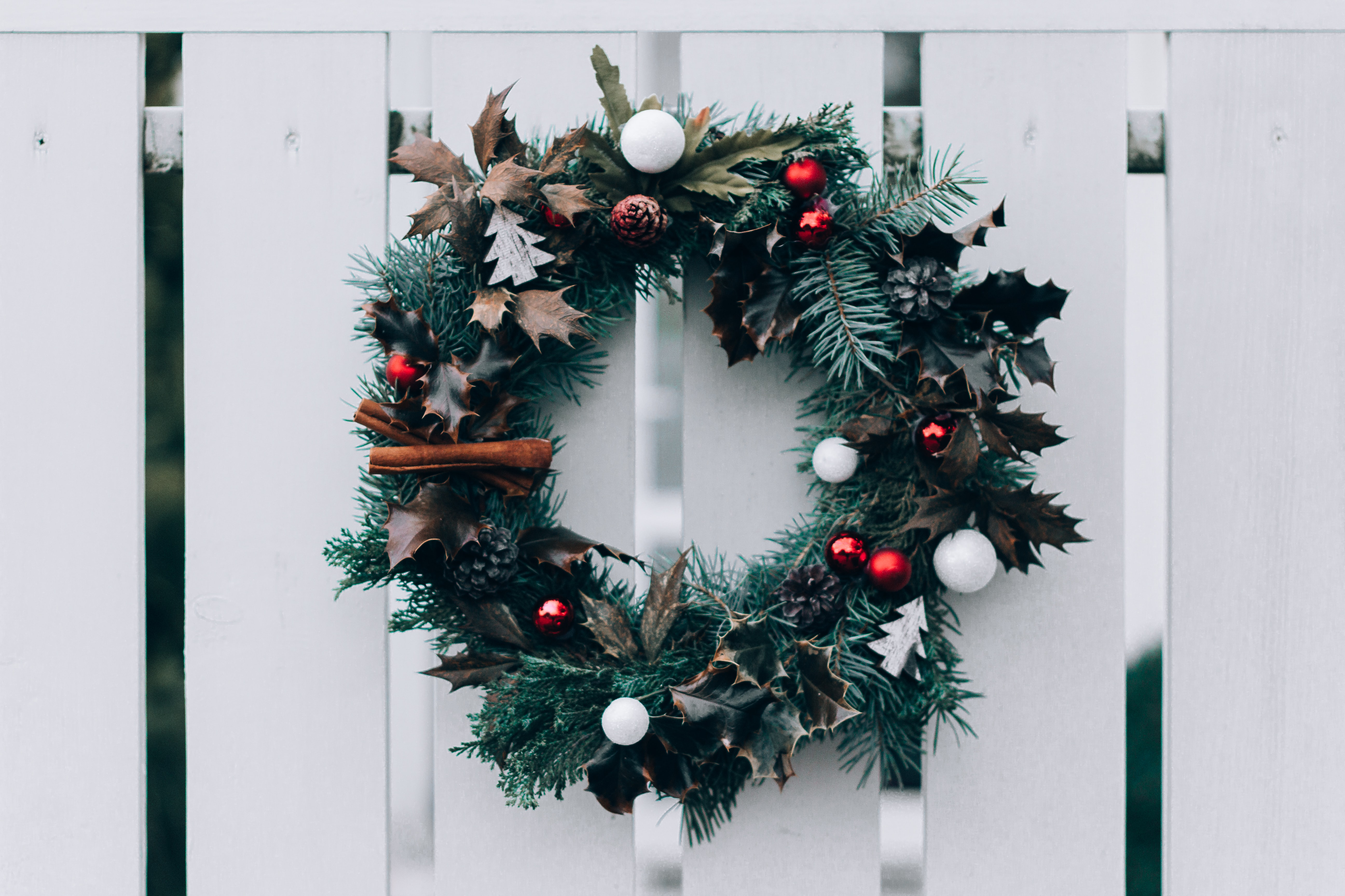 green and white Christmas wreath on wall