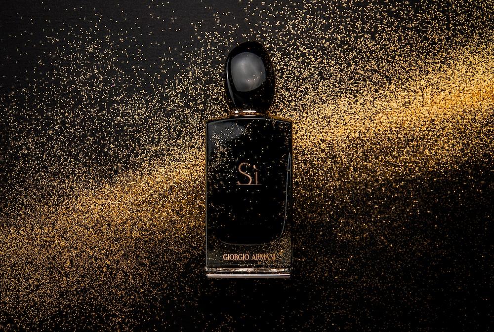 black glass perfume bottle showing front label
