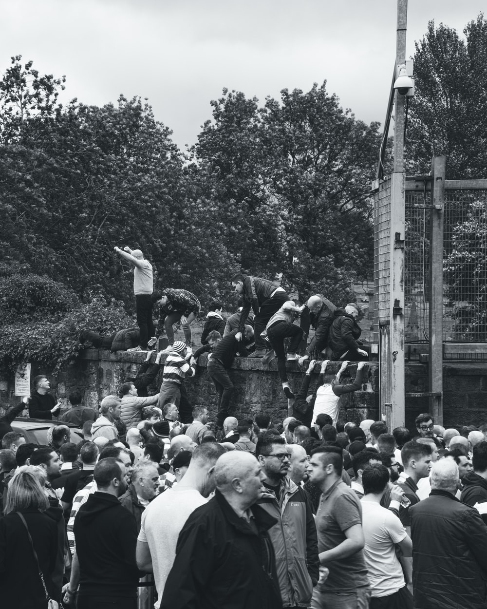 grayscale photography of people gathering