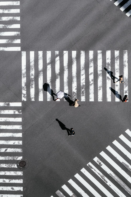 bird's-eye view photography of people crossing street