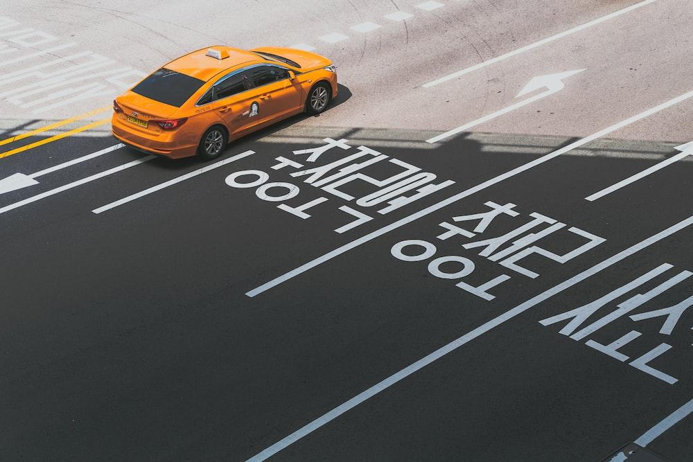 orange sedan with text overlay