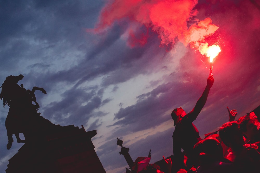 man holding red torch