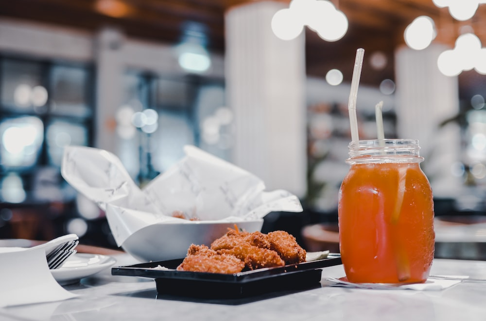 fried chicken and juice in glass jar