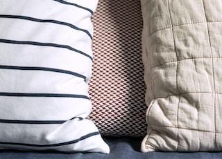 two white and gray throw pillows