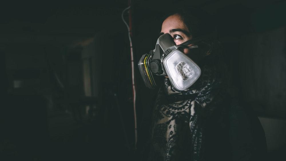 woman wearing black respirator