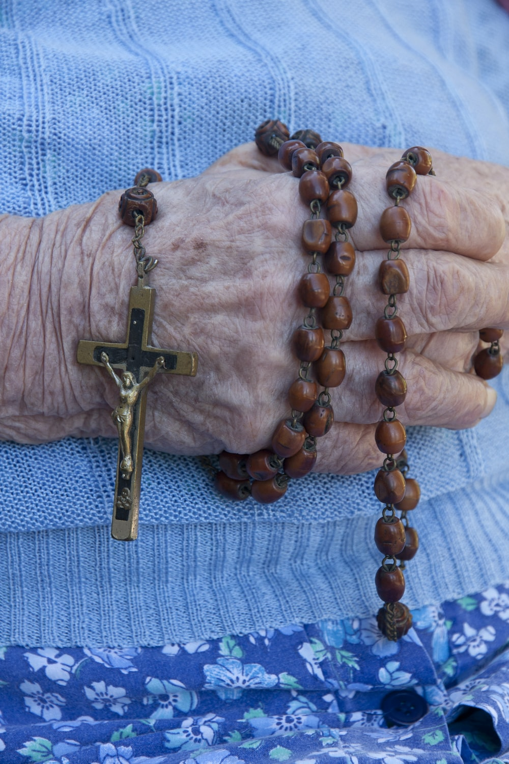 person holding rosary