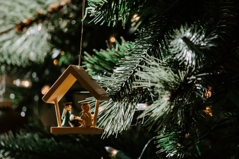 The Nativity of Christ-themed wooden Christmas ornament