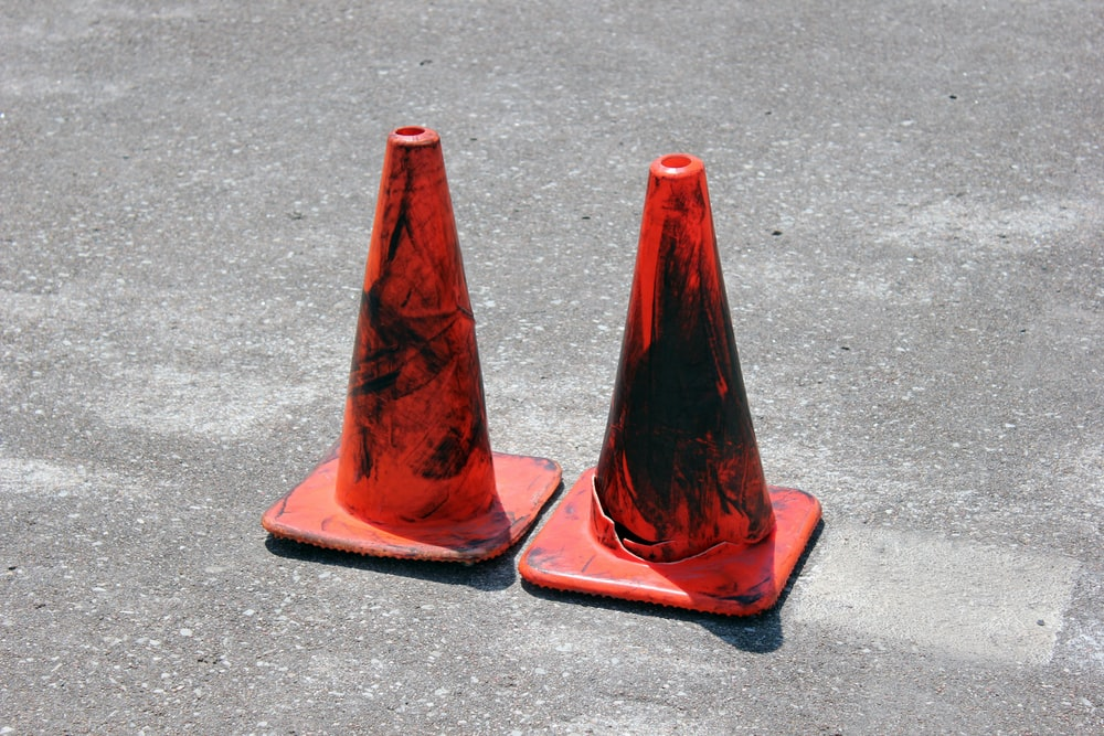 two red traffic cones